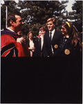 Page 195: Governor Mario Cuomo chatting with student members of Purple and Gold following Commencement.