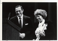 Page 209 C-Bottom Right: Novelist Toni Morrison receiving the Governor's Arts Award from Governor Mario Cuomo.  Morrison joined the University at Albany faculty from 1985 to 1989 as the holder of the Schweitzer Chair in the Humanities. (photograph missing)