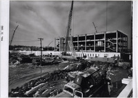 Page 125 B-Top Right: A section of pre-cast concrete is hoisted onto the Education Building.