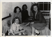 Page 100 A-Top: Students in a Sayles Hall dorm room.
