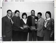 Page 213 B-Bottom: Homecoming 1990: (l to r) President Swygert, Howard Gross, President's Outstanding Young Alumni Service Award Winners Patty E. Salkin, '85 and Frederick Brewington, '79, Adrienne Brewington and Alumni Association President Susan VanHorn Shipherd, '64.