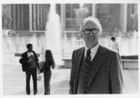 Vincent O'Leary stands in front of the large fountain on the Uptown Campus, ca. 1985