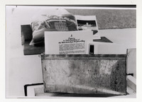 Page 127 B-Bottom: The time capsule placed into the Dutch Quad cornerstone.