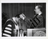Page 217: Chancellor of the State University of New York D. Bruce Johnstone presents the Presidential Medallion to H. Patrick Swygert at the President's Inauguration.