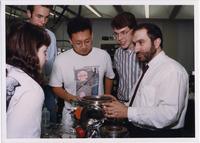 Page 176: Physics Professor Alain Kaloyeros with graduate students.