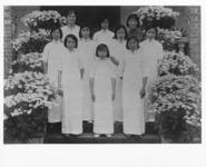 A picture of Edna Merritt (back row, far left),...