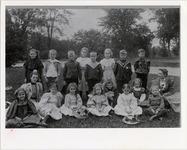 Page 46: Principal Anna Pierce, '84 and Aurelia Hyde, '95 with Model Primary School Students in Washington Park