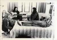 Page 149 A-Top: Students in a dorm room with a guitar.